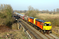 Orange livery 20314 & 20311 with Railfreight livery 20118 & 20132 at rear at Clay Mills near Burton Upon Trent on 12.3.14 with 7X09 1554 Derby Litchurch Lane - Amersham return S Stock after mods