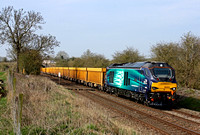 68005 'Defiant' passes the foot crossing west of Narborough Station heading towards Wigston North Junction on 8.4.15 with 6U76 0859 Crewe Bas Hall S.S.M. - Mountsorrel Sdgs empty yellow IOA wagons