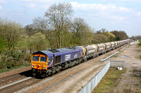 66725 'Sunderland' dashes through Stenson Junction on 8.4.15 with 6Z32 1051 Tinsley Yard - Coton Hill Tc empty aggregate hoppers. Some tree pruning has taken place here allowing the canal to be seen