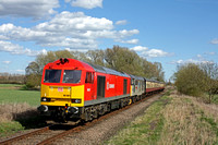 DB Schenker 60001 and 31271 move smoothly pass Castor on 11.4.15 with 1450 Peterborough - Wansford service at the Nene Valley Railway Diesel Gala April 2015