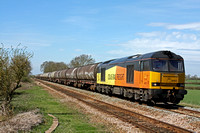 Colas Rail Freight 60021 powers along the straight at Muston near Bottesford on 14.4.15 with 6E82 1216 Rectory Jn (Colwick ) - Lindsey Oil Refinery Colas empty bogie tanks
