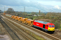 60079 with a mix a Network Rail and Railtrack liveried Autoballasters at Loughborough on 2.2.12 with 6Z60 1130 Toton Up - Peterborough test run for the latest Class 60 Supertug  conversion