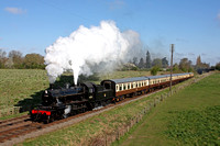 LMS Ivatt Class 2 2-6-0 No 46521 passes Woodthorpe in glorious sunshine on 18.4.15 with 0915 Loughborough - Leicester North service at the GCR Railways at Work Weekend