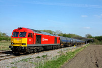 60001 in DB Schenker livery waits at Stenson Bubble heading towards Stenson Junction on 20.4.15 with 6M00 1140 Humber Oil Refinery - Kingsbury Oil Sdgs loaded blue bogie tanks