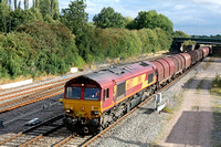 66037 at Trowell  on the Erewash Valley Line heads north on 8.8.11 with 6E79  Wolves - Scunthorpe empty steel carriers