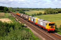 Railfreight 20132 & 20118 lead 2 tank barriers with HNRC Orange livery 20311 & 20314 at rear  is seen from Syston bypass roadbridge  on 15.6.15 with 6M24 0845 Derby Adtranz Litchurch Lane move