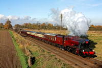 Red 8F No 48624 adorned with a Poppy Wreath for Remembrance Sunday at  Woodthorpe, GCR on 11.11.12 with 1315 Loughborough - Leicester North  'The Elizabethan' Sunday Luncheon Dining service