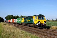 Freightliner 70011  is seen at East Goscote near Syston East Jn on 9.7.15 with diverted 4M93 1334 Felixstowe North F.L.T. - Lawley Street F.L.T. liner via Melton Mowbray line in lovely early evening l