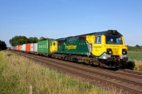 Freightliner 70011  passes East Goscote near Syston East Jn on 9.7.15 with diverted 4M93 1334 Felixstowe North F.L.T. - Lawley Street F.L.T. liner via Melton Mowbray line in lovely early evening light