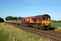 66035 approaches Broome Lane Crossing, East Goscote, near Syston East Junction on 9.7.15 with 6M88 1435 Middleton Towers - Ellesmere Port (Db Schenker) loaded KEA sand wagons
