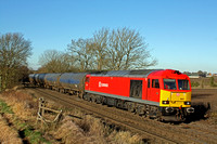 60011 in DB Schenker livery at Chellaston heading towards Castle Donington on 5.12.12 with 6E54 1040 Kingsbury Oil Sdgs - Humber OIl Refinery empty blue bogie tanks in lovely winter sun