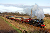 LMS Ivatt Class 2 2-6-0 No 46521 at Woodthorpe, on 15.12.12 with 1315 'The South Yorkshireman' Loughborough - Leicester North GCR dining train and the Directors Saloon ,999503, the Arrowvale Belle