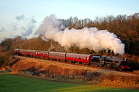 LMS Black 5 No 44767'George Stephenson at Kinchley Lane on 31.1.10 with 1545 Loughborough - Leicester North service at the GCR Winter Steam Gala January 2010 in the low setting sun