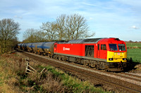 60079 in DB Schenker livery at Chellaston heading towards Castle Donington on 2.12.14 with 6E54 1040 Kingsbury Oil Sdgs - Humber Oil Refinery empty blue bogie tanks in lovely wintery sun