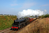 Under a lovely blue sky LMS Class 5 (Black Five) 4-6-0 No 45305 blasts past Little Woodthorpe, GCR on 19.9.15 with 1000 Loughborough - Leicester North service at the GCR Beer Festival 2015