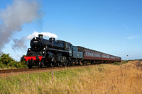 BR Standard 4 No 76084 approaches Weybourne seen close to Sheringham Park on the North Norfolk Railway on 01.10.15 with 1200 Sheringham - Holt service