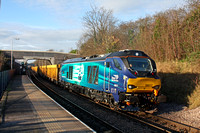 Latest DRS Class 68 in service  No 68017 'Hornet' speeds through South Wigston station on 2.12.15 with 6U76 0859 Crewe Bas Hall S.S.M. - Mountsorrel Sdgs empty IOA wagons in lovely winter sunlight