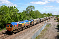 A dirty Rainbow livery  66720 at Stenson Junction on 1.6.13 with 4Z96 0925 Drax - Liverpool Bulk Terminal empty Biomass hoppers