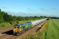 Freightliner 66622 passes Cossington, MML heading for Syston East Junction on 14.7.16  with 6L44 0522 Tunstead Sdgs - West Thurrock Sidings loaded new JGA cement tanks in beautiful light