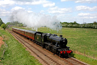 LMS 8F No 48624 passes Woodthorpe on 14.5.16 with 1515 Loughborough - Leicester North GCR service on a beautiful Spring afternoon