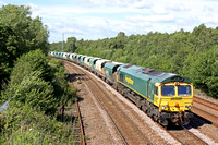 Freightliner 66620 powers round the curve at Stanton Gate heading towards Toton Yard on 5.7.16 with 6V08 1332 Tunstead Sdgs - Brentford Town Days loaded stone hoppers