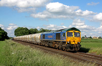 Freightliner 66623 'Bill Bolsover' in blue livery passes East Goscote heading towards Syston East Junction on 20.6.16 with 6M92  1223 West Thurrock Sidings Fhh -Tunstead Sdgs empty cement tanks