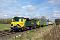 Freightliner Class 70 No 70018 motors past East Goscote, west of Melton Mowbray  near Syston East Junction on 2.4.16 with diverted 4M87 0938 Felixstowe North F.L.T. to Crewe Bas Hall S.S.N. well loade