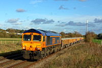 GBRf 66728 'Institute of Railway Operators' nears Narborough Foot Crossing heading towards Hinckley on 3.11.14 with 6G16 1124 Cliffe Hill Stud Farm Gbrf -Bescot Up Engineers Sdgs loaded low JNA ballas