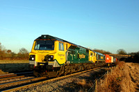 Freightliner 70015 with 66598 (DIT) passes Stenson Bubble heading for Stenson Junction on 5.1.17 with 4O95  1213 Leeds F.L.T. - Southampton M.C.T. loaded liner in low sun
