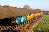 DRS 68016 powers past Barrow Upon Trent heading towards Stenson Junction on 20.1.17 with 6U77 1342 Mountsorrel Sdgs  Crewe Bas Hall S.S.N. loaded 1OA  yellow ballast wagons