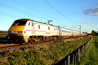 East Coast liveried Class 91 No 91131 with DVT 82206 at rear at Hougham north of Grantham on 4.11.13 with 1B86 1408 London Kings Cross - Newark North Gate service in the low setting sun