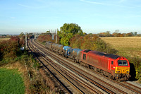 67018 'Keith Heller' in DB Schenker red livery at Kilby Bridge, MML with Arriva blue 67002 at rear on 02.11.16 with 3J92 2342 Toton T.M.D. -  West Hampstead North Jn. RHTT working