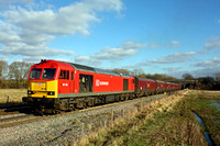 60100 in DB red Schenker livery passes Stenson Bubble heading for Stenson Junction on 6.2.15 with 6Z37  1132 Ratcliffe P.S. -  Arpley Sidings empty coal hoppers