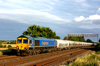 Freightliner 66623 'Bill Bolsover' in blue livery heads northwards at Cossington, MML on 9.8.17 with 6M84 1306 Dagenham Down Yard - Hope (Earles Sidings) empty cement tanks