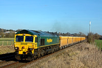 Freightliner 66515 at Narborough heading towards Hinckley on 18.2.15 with  6G16 1124 Cliffe Hill Stud Farm - Bescot Up Engineers Sdgs loaded yellow Network Rail IOA ballast wagons