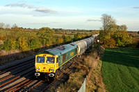 Freightliner 66614  recently named 'Poppy' 1916 - 2016 runs into the bi-directional loop at Kilby Bridge, MML nr Wigston on 2.11.16 with 6M91 1113 Theale Lafarge - Hope (Earles Sidings) empty cement t