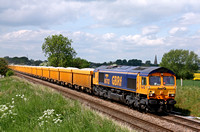 GBRf 66702 'Blue Lightning' at Copleys Brook, Melton Mowbray on 27.5.10 with 6L24 1027 Mountsorrel Sdgs - Whitemoor Yard loaded yellow IOA wagons