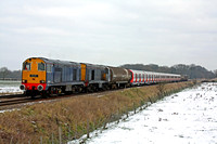 In poor light and snow on the ground on 8.2.12  20301 &20305 tnt 20302 &20304 at Rearsby near Melton Mowbray  with 7X09 11142 Old Dalby - Amersham with new Underground tube S Stock and tank barriers