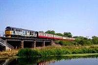 31271 crosses the River Nene bridge at Wansford on 25.7.06 with 1100 Peterborough NVR - Wansford service