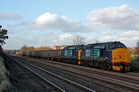 37688 and 37510 at Astoril Crossing, Cossington, MML heading towards Leicester on 3.2.11 with 6Z50 0925 Stockton - Sheerness loaded scrap wagons