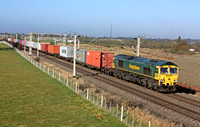 66563 at Barby Nortoft  south of Rugby on 3.2.11 with 4O35 0923 Crewe Basford Hall - Southampton Freightliner.