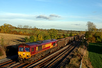 DB Cargo 66184 passes a stunning sunlite autumn scene at Kilby Bridge near Wigston on 2.11.16 with 6Z78 1338 Luton Crescent Road - Humberstone Road empty JNA wagons
