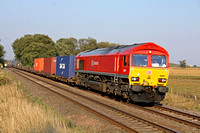 DB Schenker livery 66097 at East Goscote on 3.10.11 with 4Z32 Corby - Bescot return trial empty Intermodal of just 6 containers