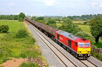 DB Schenker livery 60059 'Swinden Dalesman' at Weston on Trent near Castle Donington on 21.7.12 with 6V70 SO 1411 Lindsey OR - Didcot TC loaded bogie oil tanks