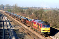 60048 'Eastern' inn standard EWS red and gold livery at Normanton on Soar heading towards Loughborough on 13.2.08 with 6M96 0548 Margam - Corby BSC loaded steel coil wagons