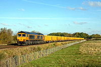 GBRf 66707 'Sir Sam Fay' gently passes Rearsby heading towards Syston East Junction on 11.11.16 with 6M60 1112 Whitemoor Yard L.D.C Gbrf - Mountsorell empty IOA yellow boxes