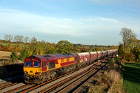 DB Cargo 66047 passes a stunning sunlite autumn scene at Kilby Bridge near Wigston on 2.11.16 with late running 6H10 0956 Bletchley R.M.C. - Peak Forest Cemex Sdgs empty hoppers