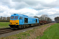 60074'Teenage Spirit' at East Goscote heading towards Syston East  Junction on 19.3.12 with 6V92 1018 Corby - Margam empty  steel coil wagons