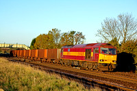 60019 at New Barnetby in early morning sun on 20.10.10 with 6K21 0806 Santon - Immingham empty iron ore tipplers