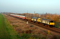 20901 & 20905  lead new S Stock with 20142 & 20227 at Catholme near Burton on Trent heading towards Wichnor Junction on 14.3.12 7X09 1142 Old Dalby - Amersham underground working in late evening sun